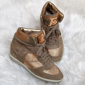 Like new! Michael Kors rose gold wedge sneakers